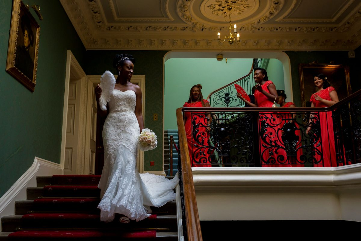 Addington Palace wedding bride walking down the stairs