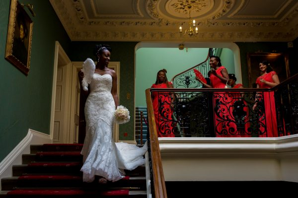 Addington Palace wedding bride walking down the stairs