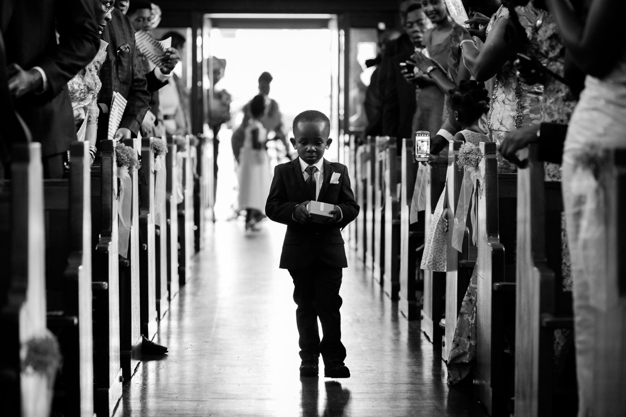 Addington Palace wedding pageboy walking down the aisle