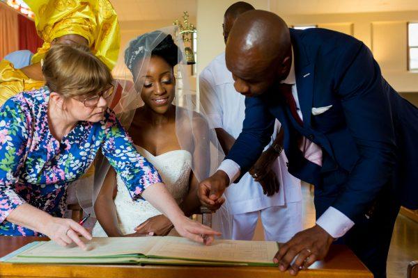 Addington Palace wedding sining the registrar