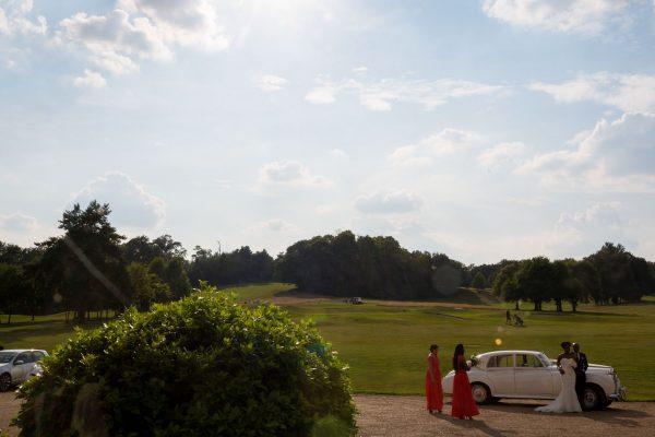 Addington Palace wedding bride and groom arriving int he car