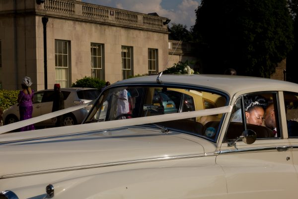 Addington Palace wedding married couple posing in the car