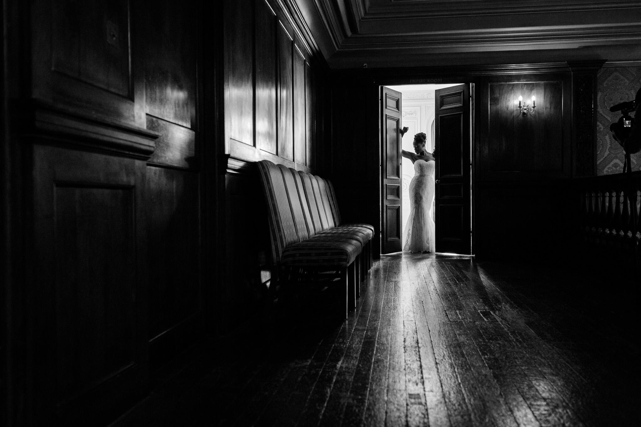 Addington Palace wedding bride posing in the doors