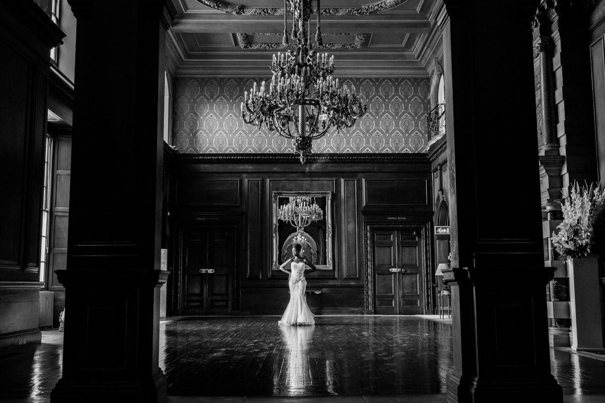 Addington Palace wedding bride posing in the venue hall