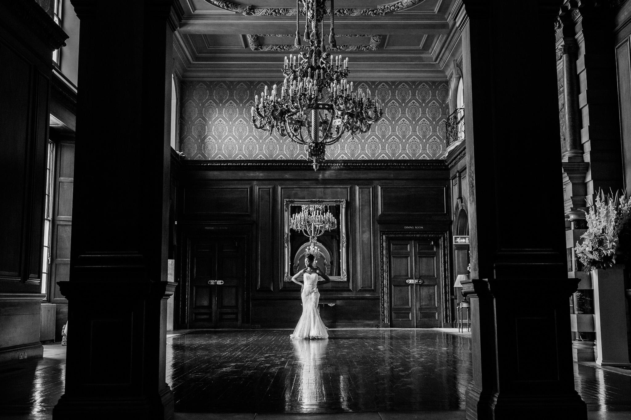 Addington Palace wedding bride posing in the venue hall
