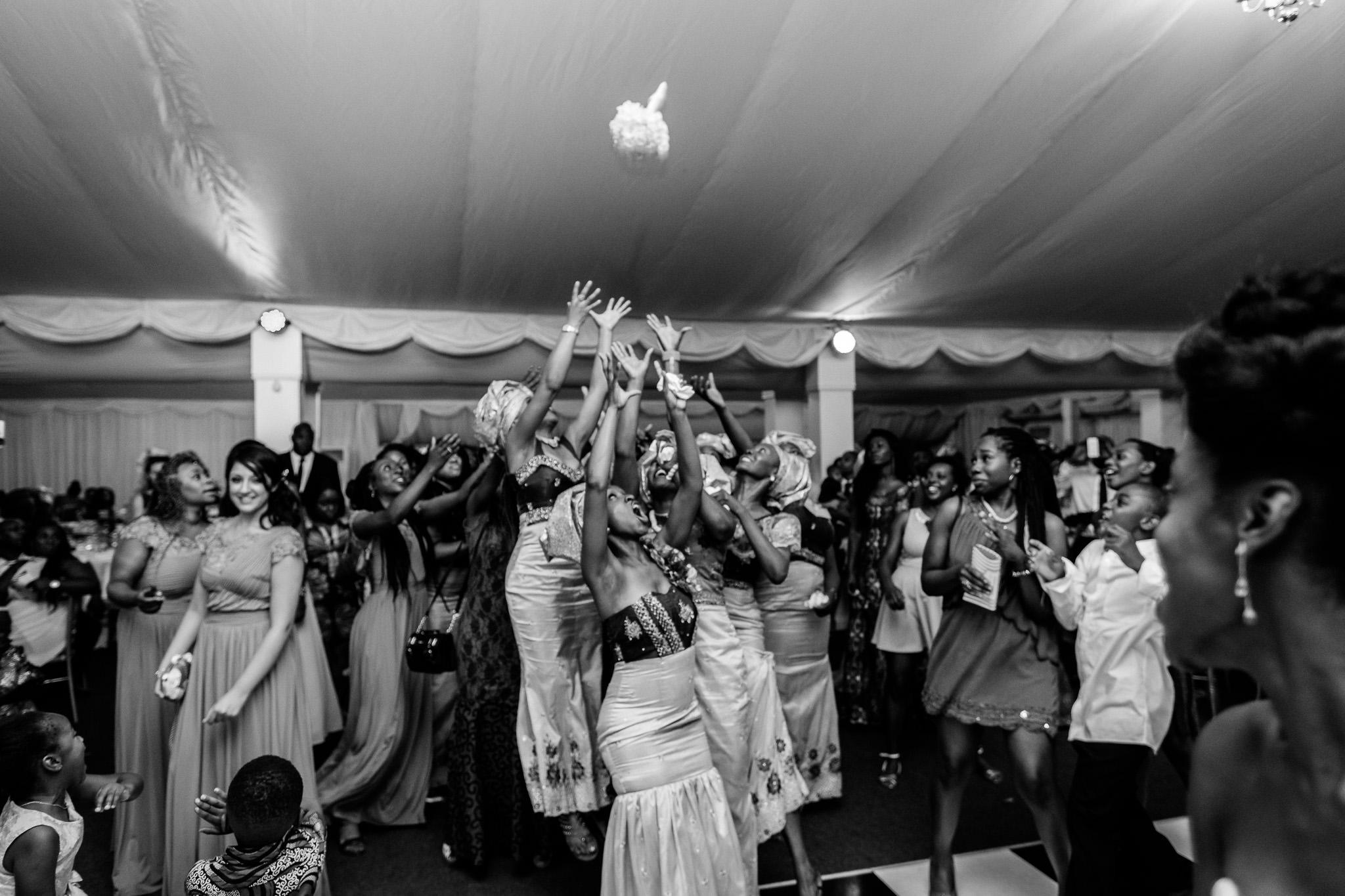 Addington Palace wedding throwing a bouquet