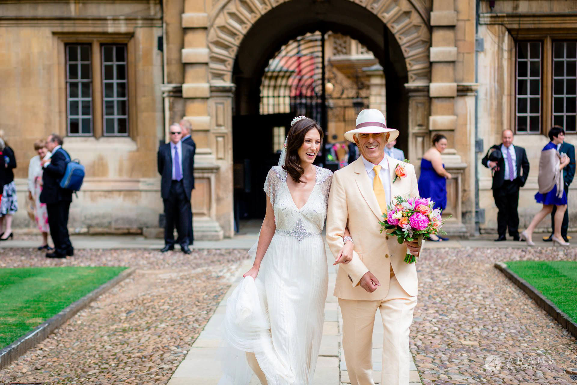 Clare College wedding bride and her father walking in the courtyard