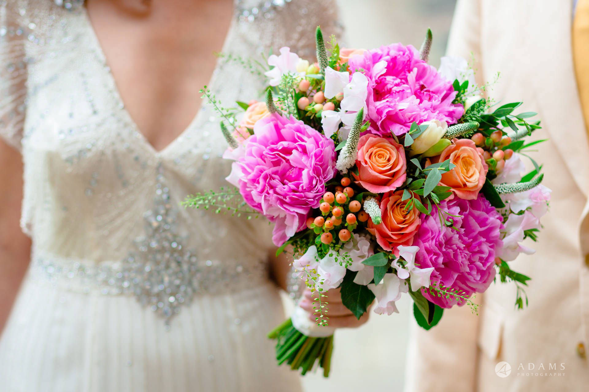 Clare College wedding bride holds flowers