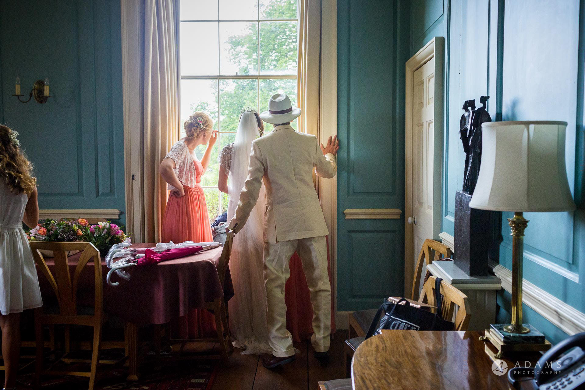 Clare College wedding bride and bridal party look over the window