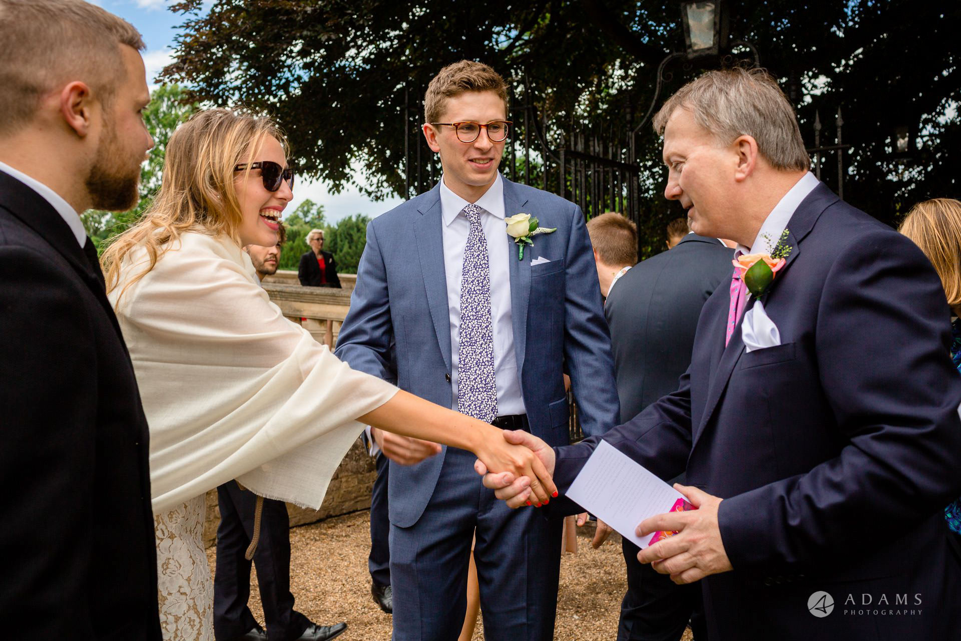 Clare College wedding guests shaking hands
