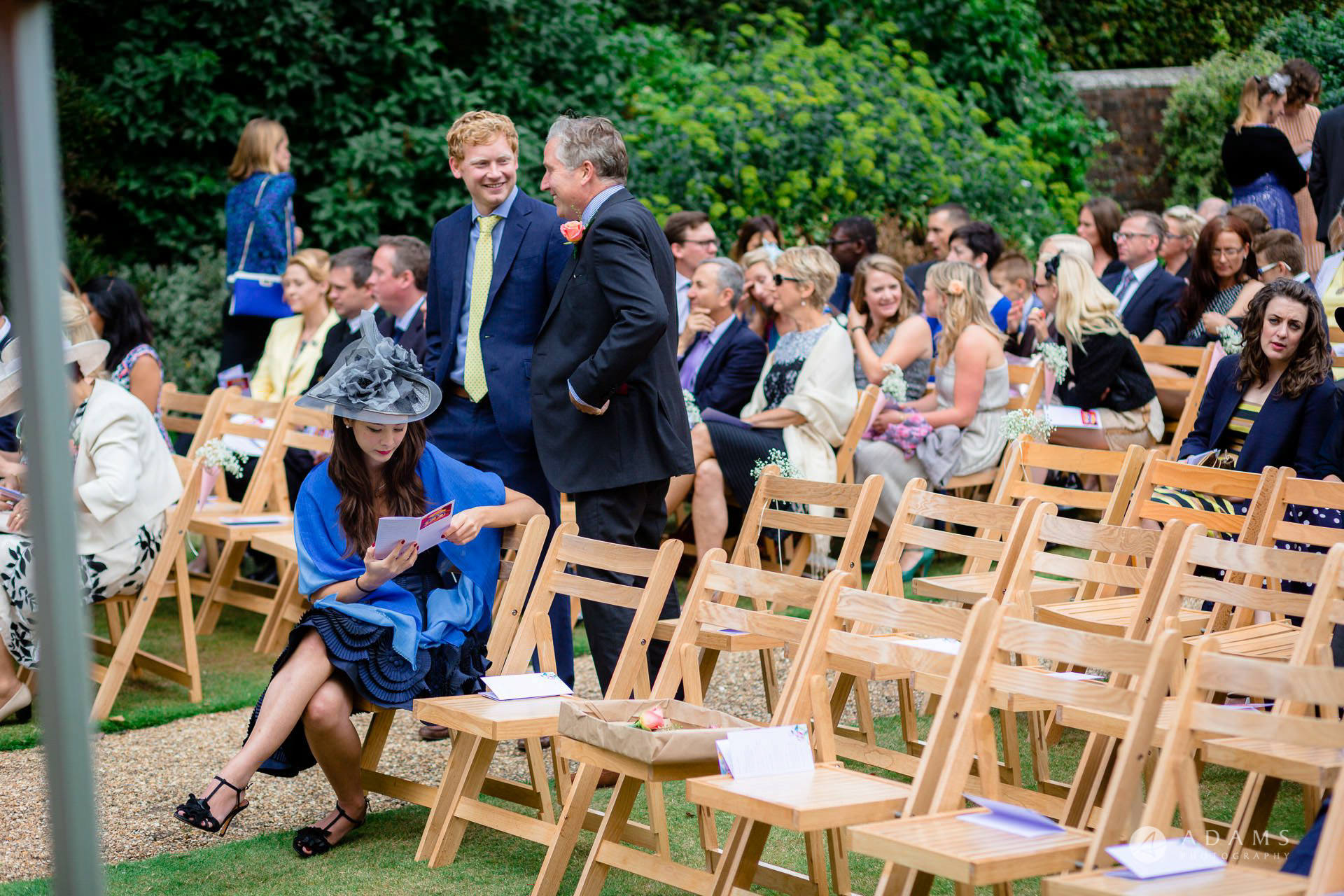 Clare College wedding guests sitting down