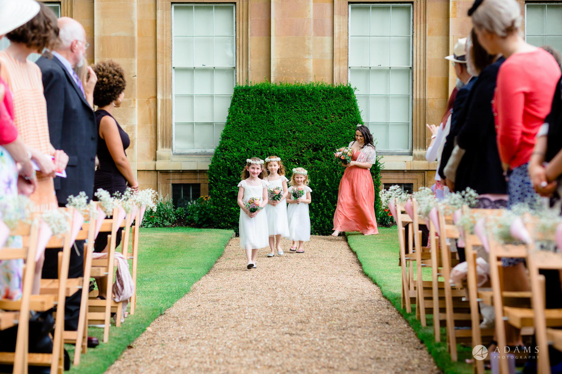 Clare College wedding flower girls approaching