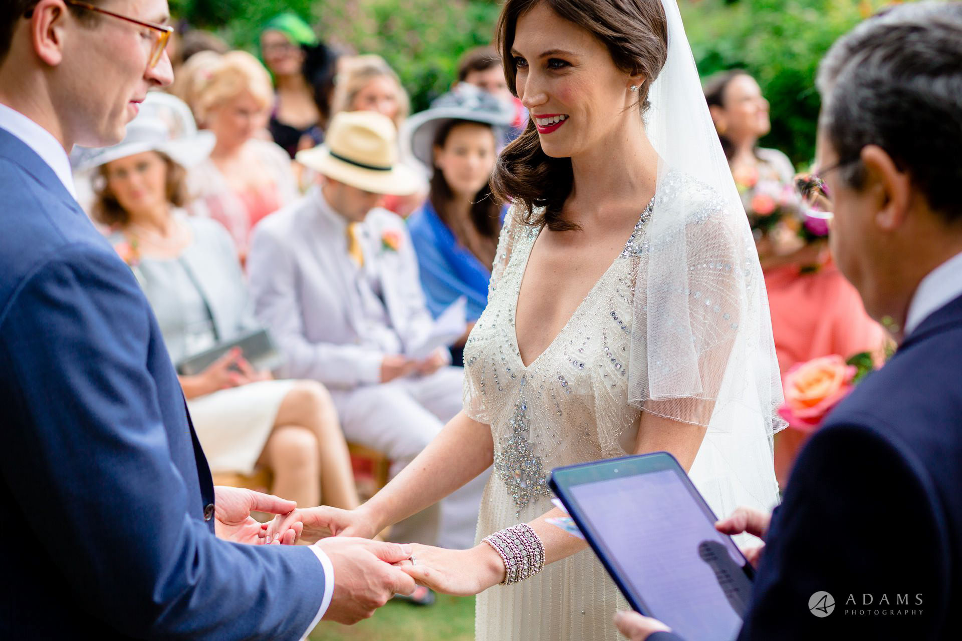 Clare College wedding bride and groom hold hands