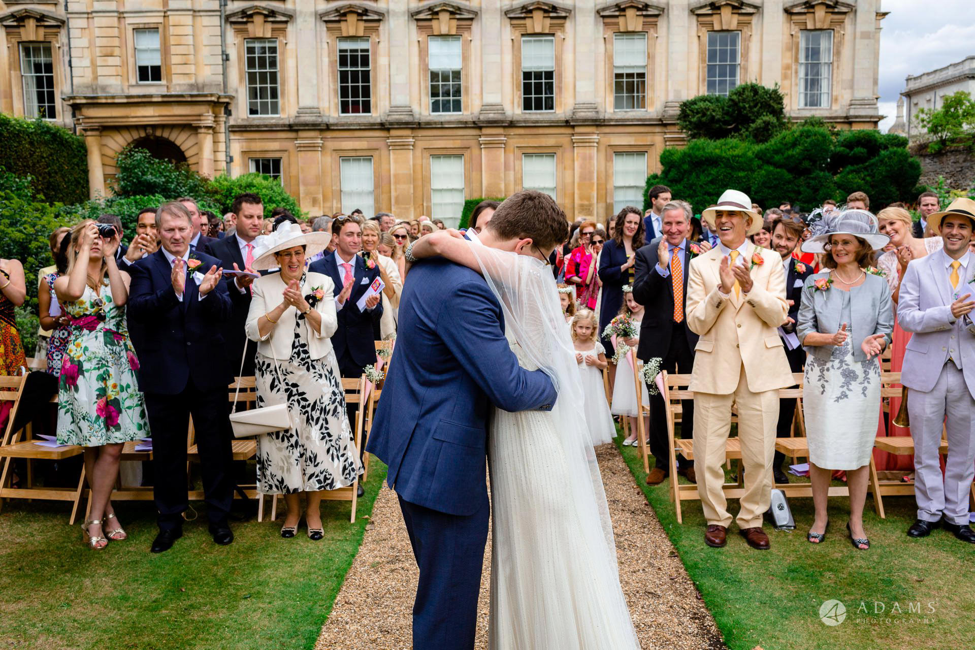 Clare College wedding bride and groom hug each other