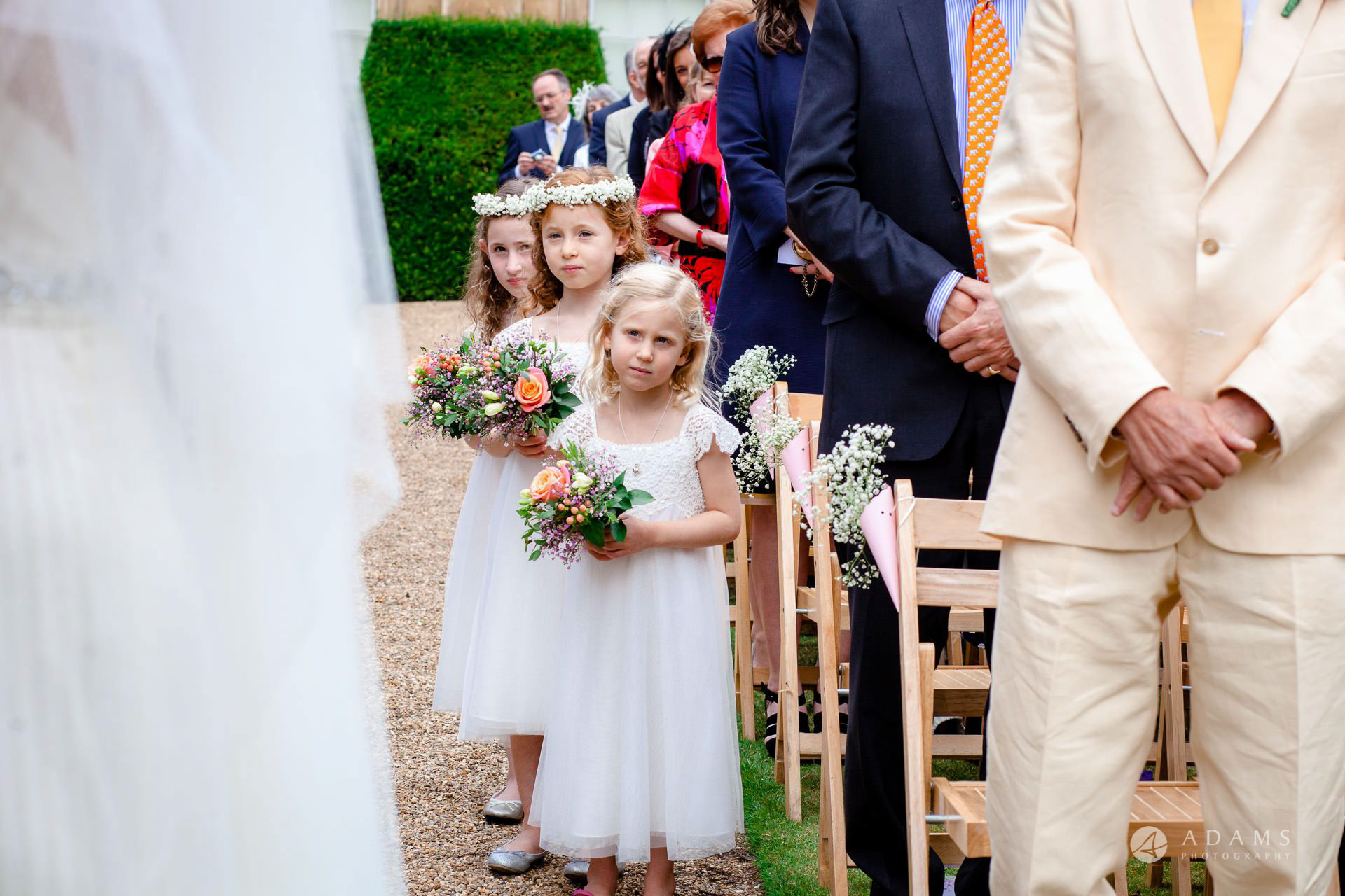 Clare College wedding flower girls look at the married couple