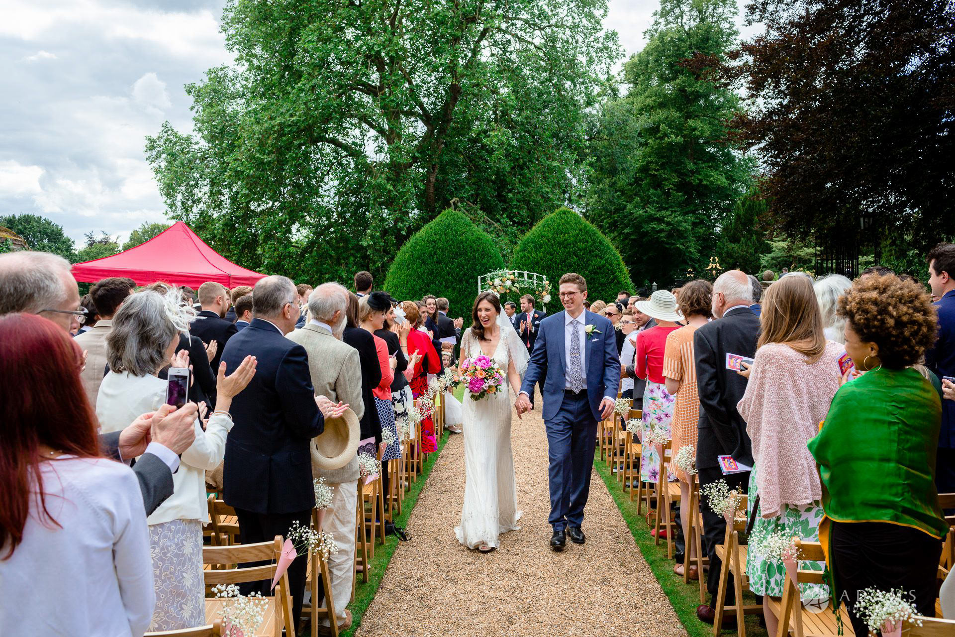 Clare College wedding married couple walks back