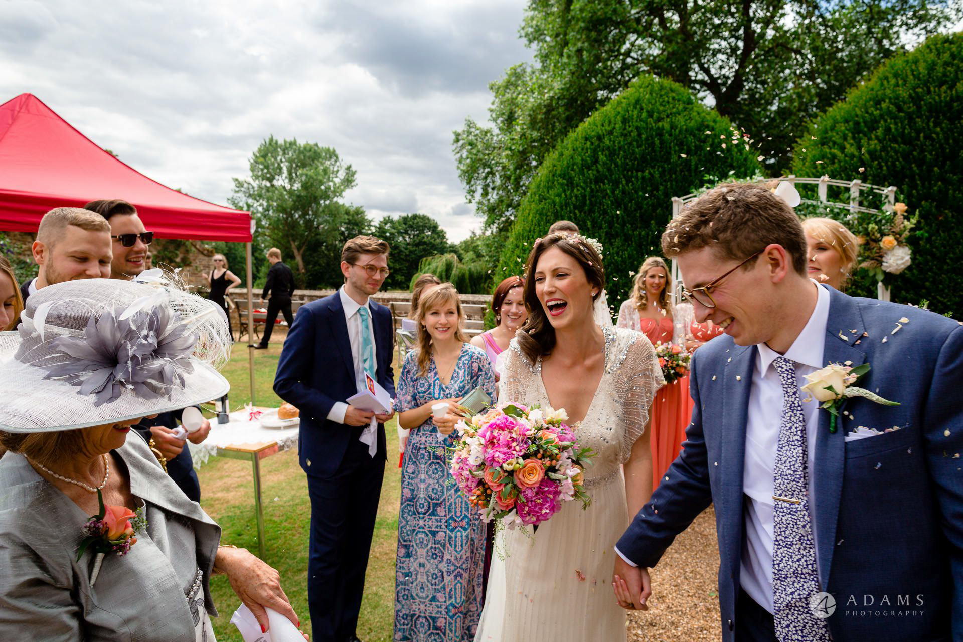 Clare College wedding photographer bride and groom start to walk to the reception venue