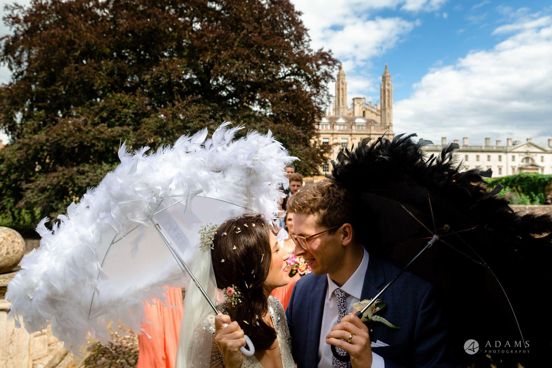 Clare College wedding photographer kiss on the bridge