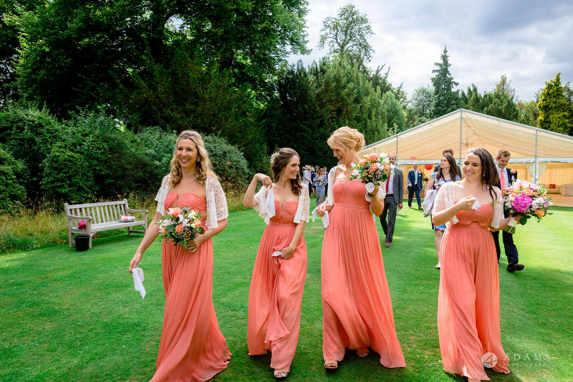 Clare College wedding photographer bridesmaids walk together