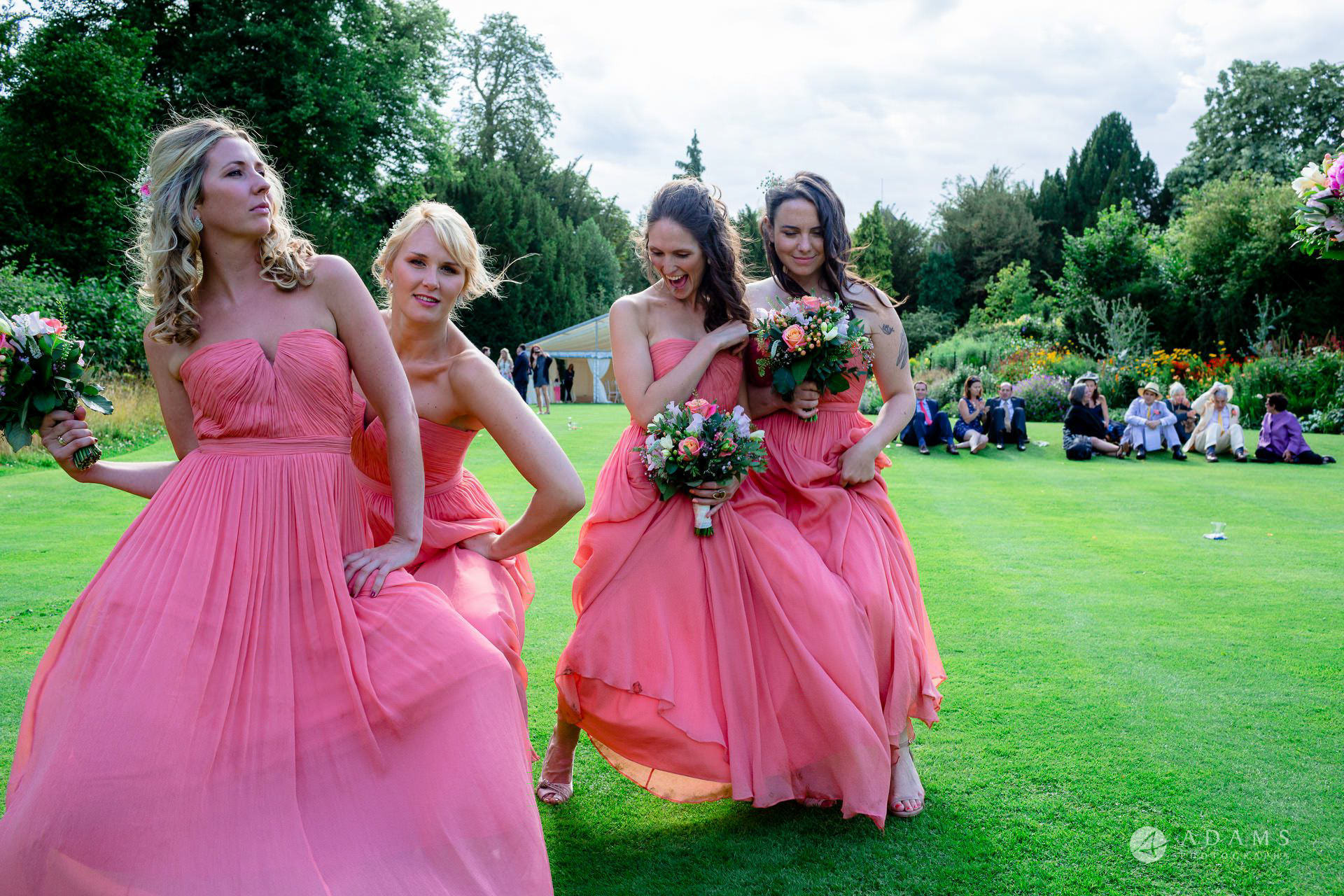 Clare College wedding photos bridesmaids dancing in front of the camera