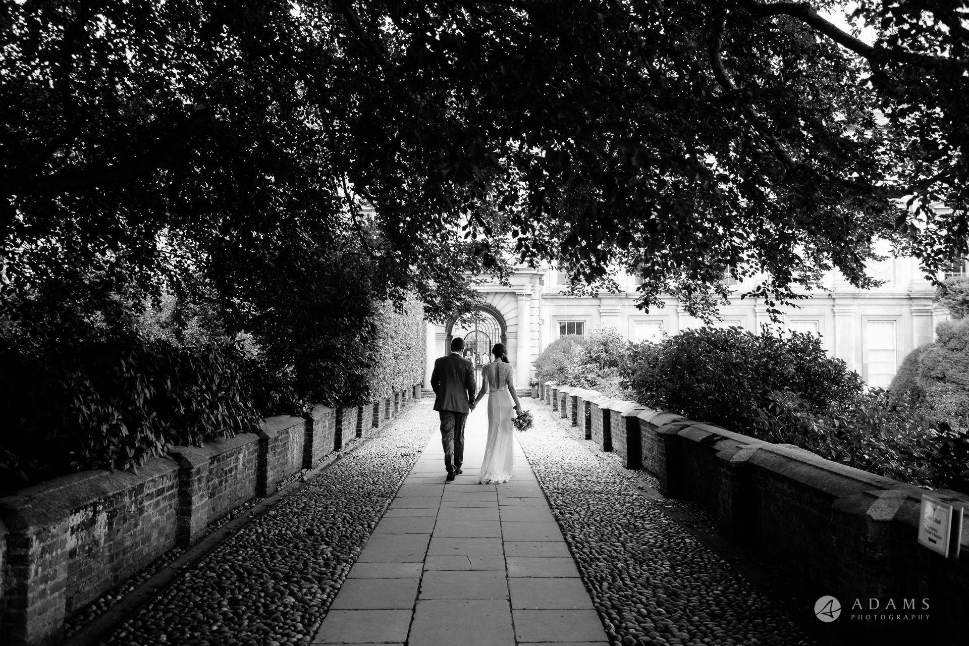 Clare College wedding couple walks away