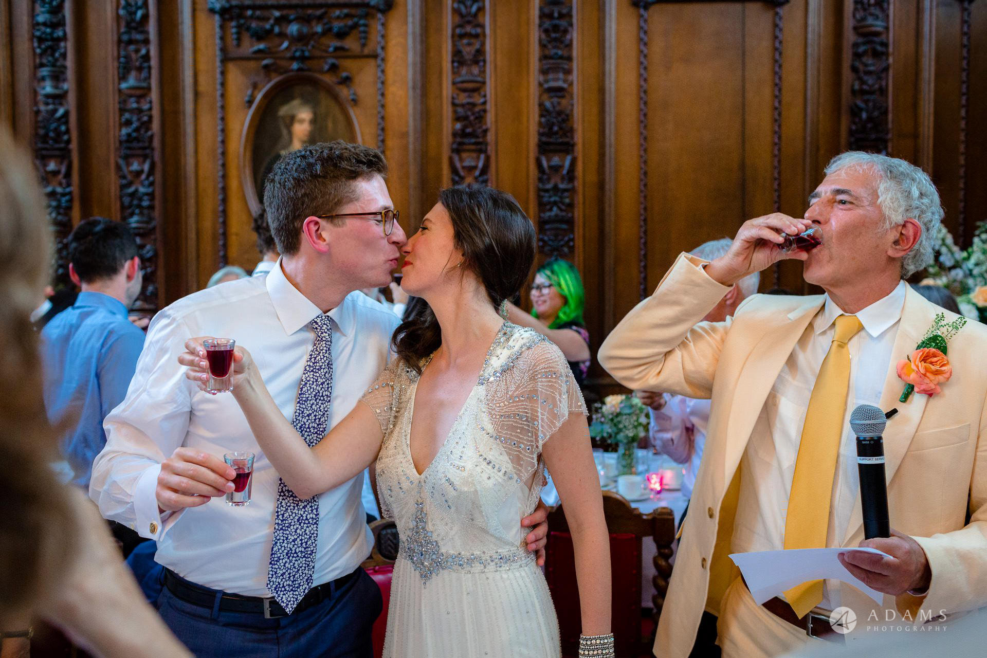 Clare College wedding married couple toast and kiss