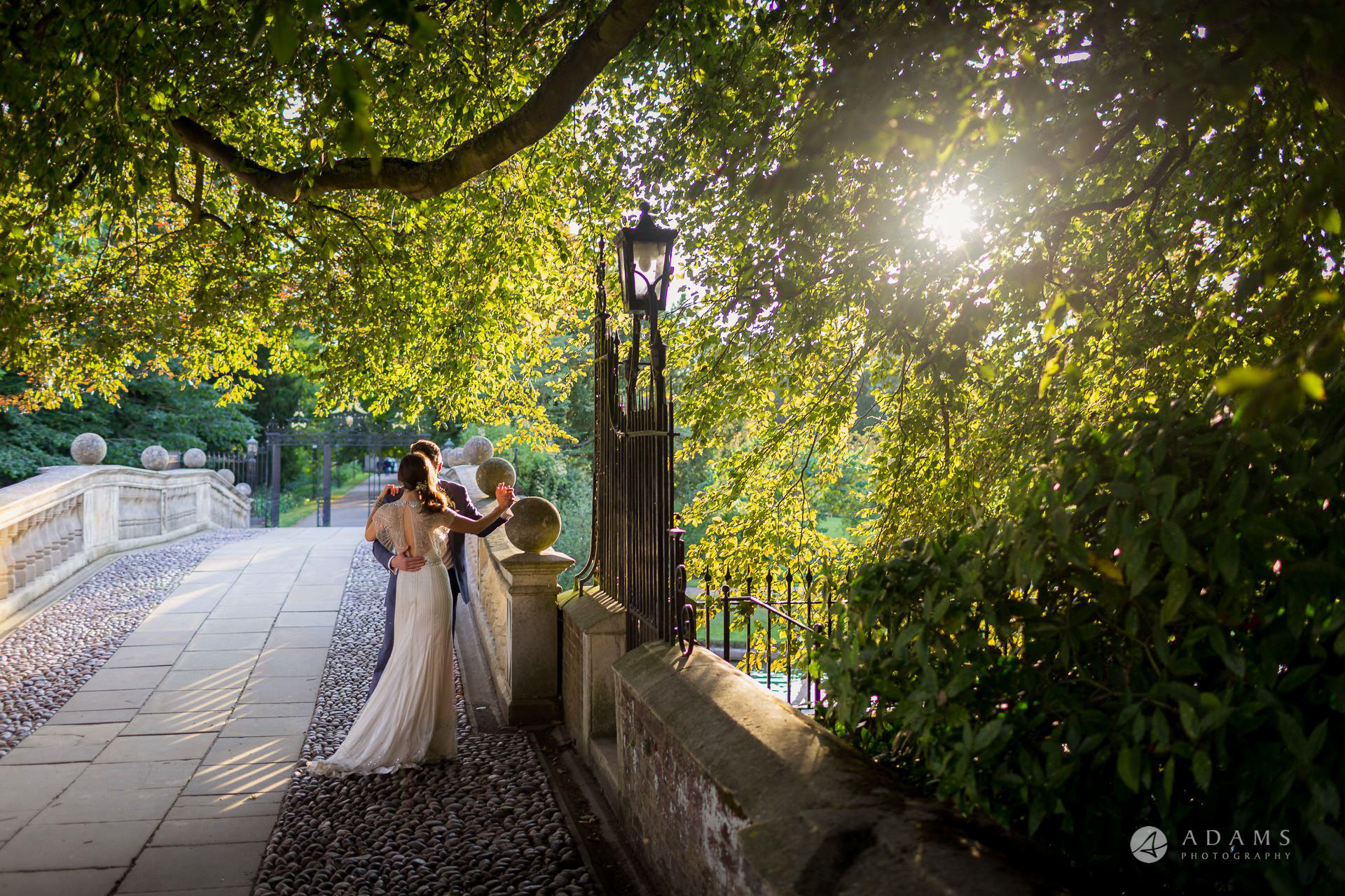Clare College wedding married couple dance on the bridge