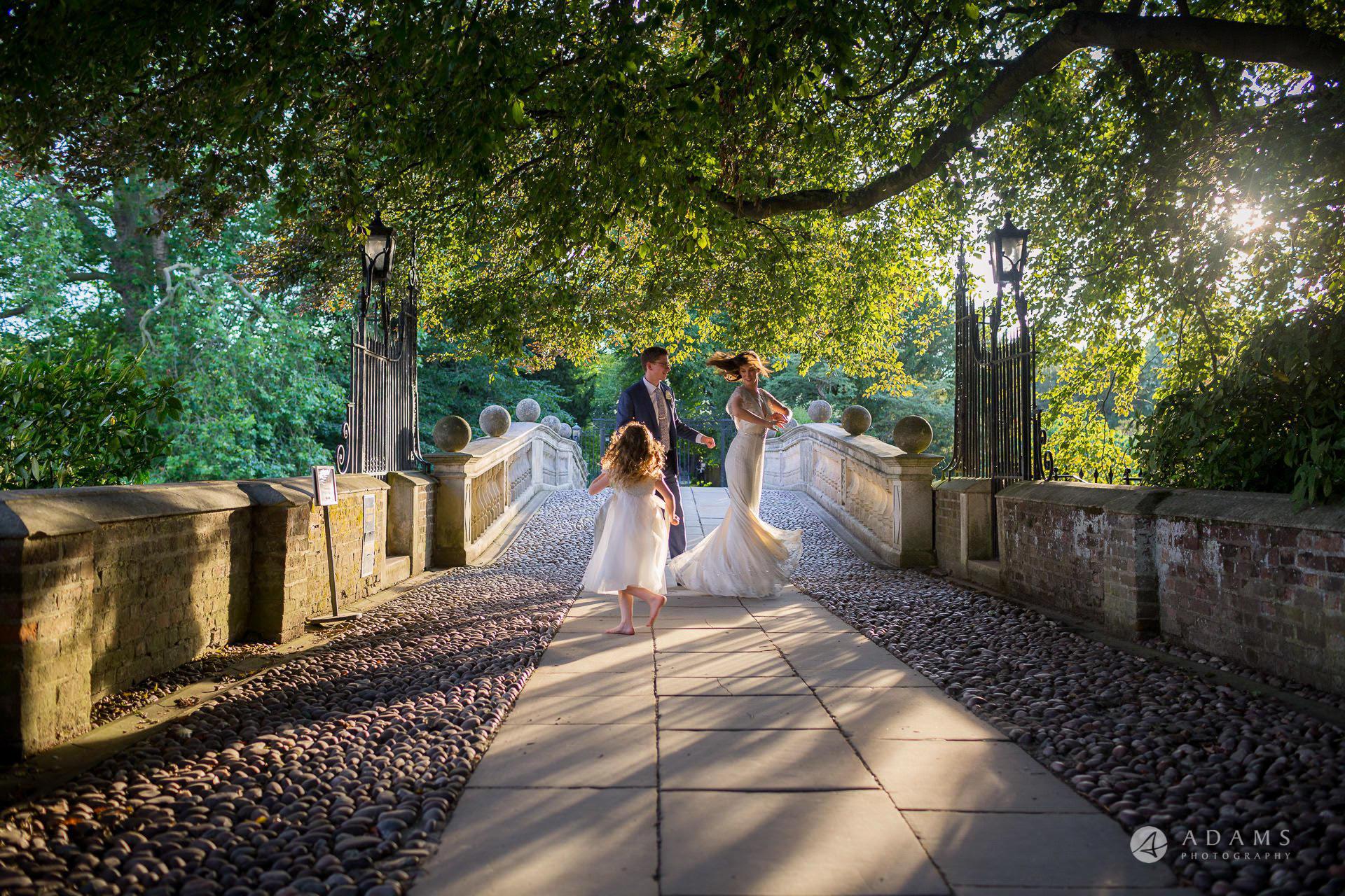 Clare College wedding golden hour dance on the bridge