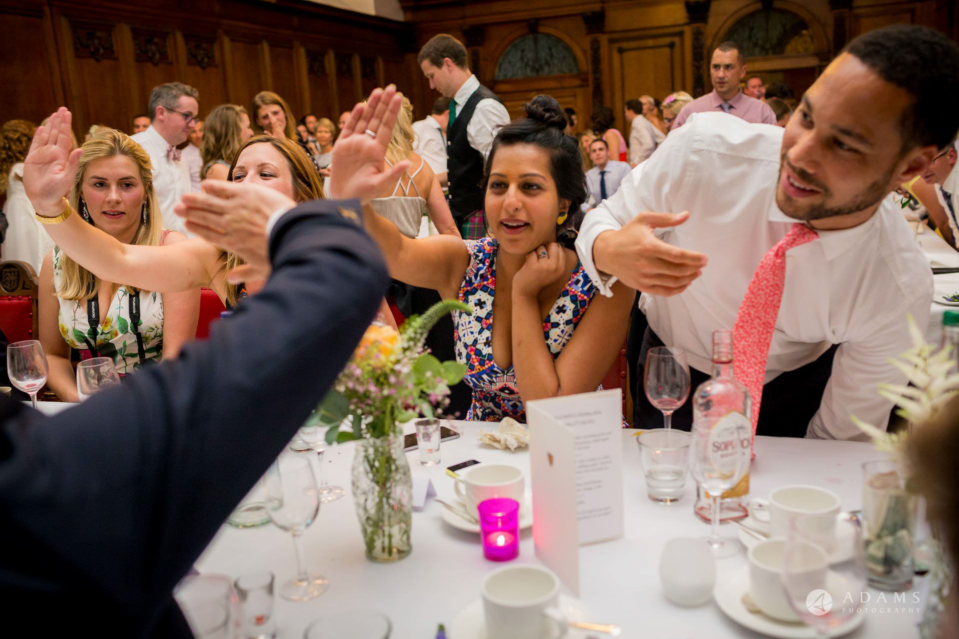 Clare College wedding guests high five