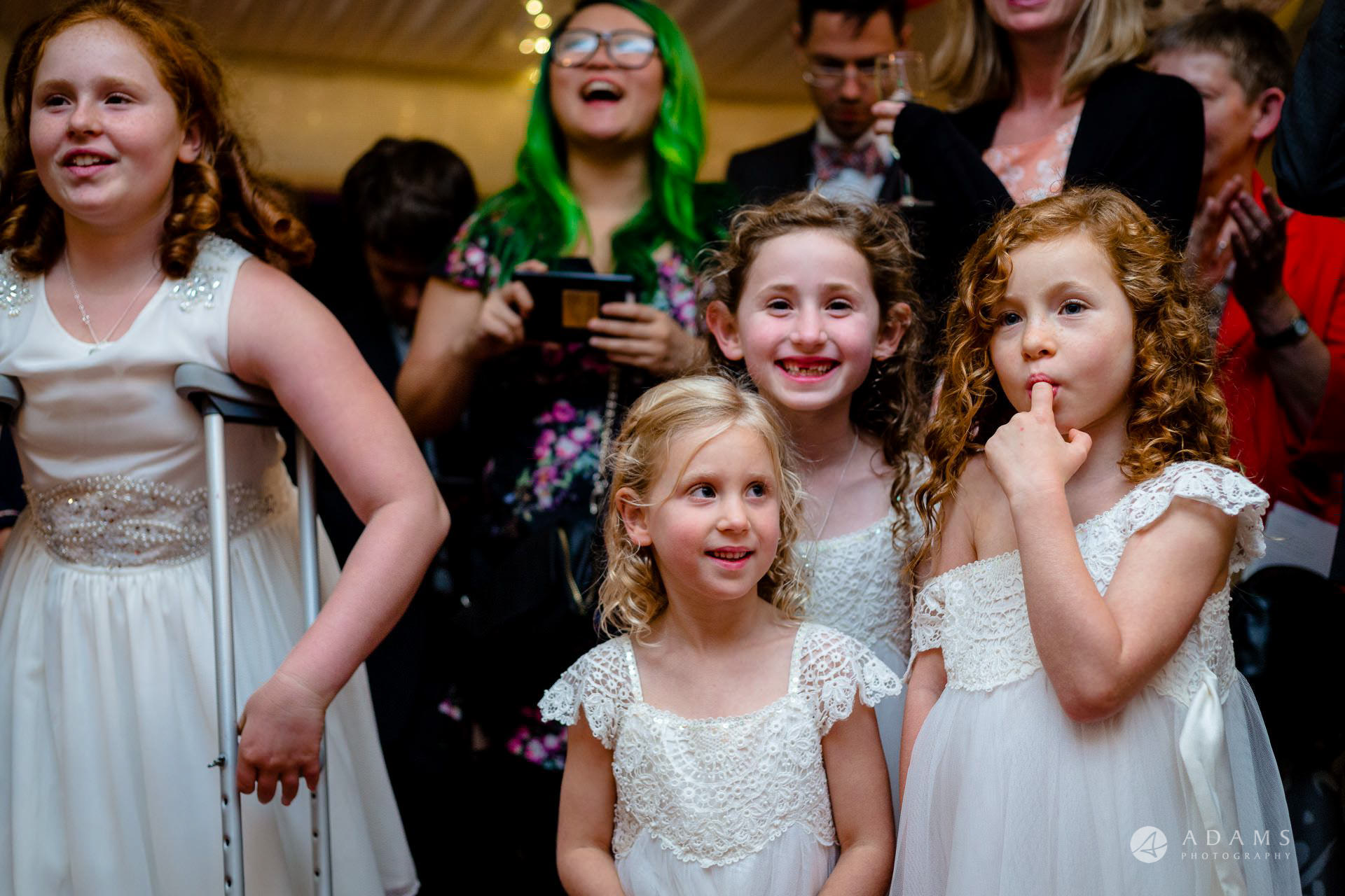 Clare College wedding flower girls look at the cake cutting