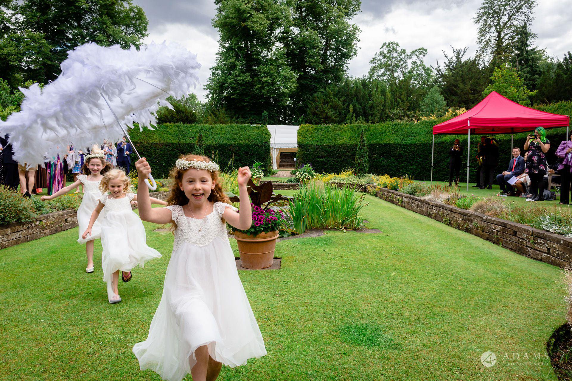 Clare College wedding photos flower girls running