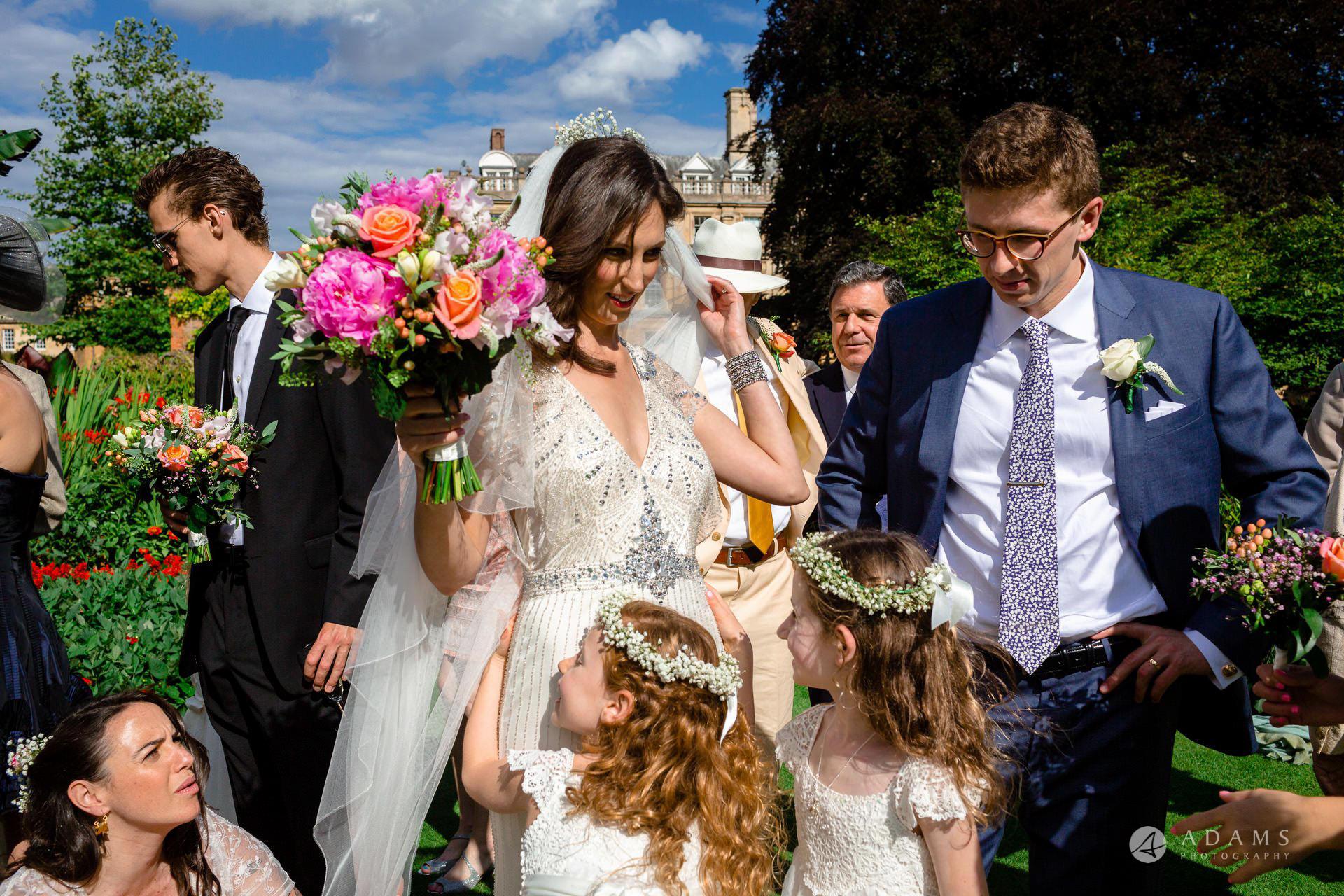 Clare College wedding photos flower girls cuddle the bride