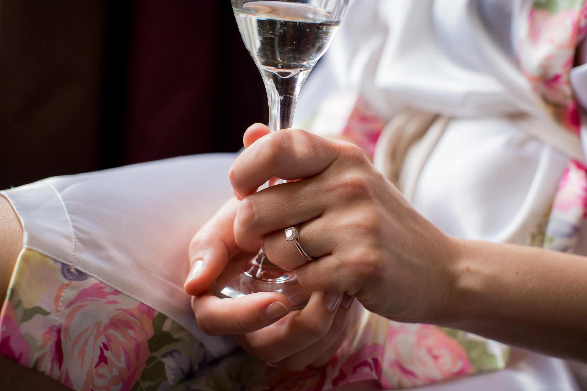 Wotton House wedding bride holding a drink