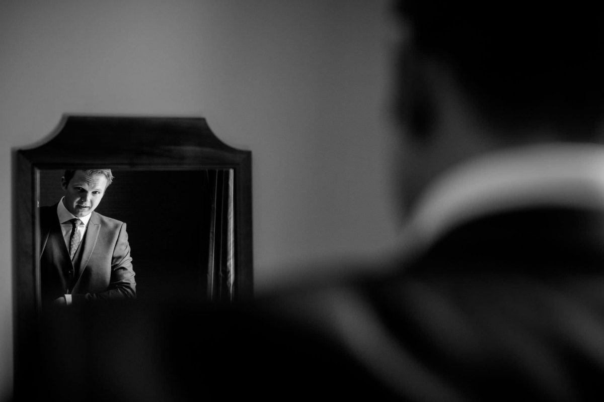 Wotton House wedding groom in the mirror