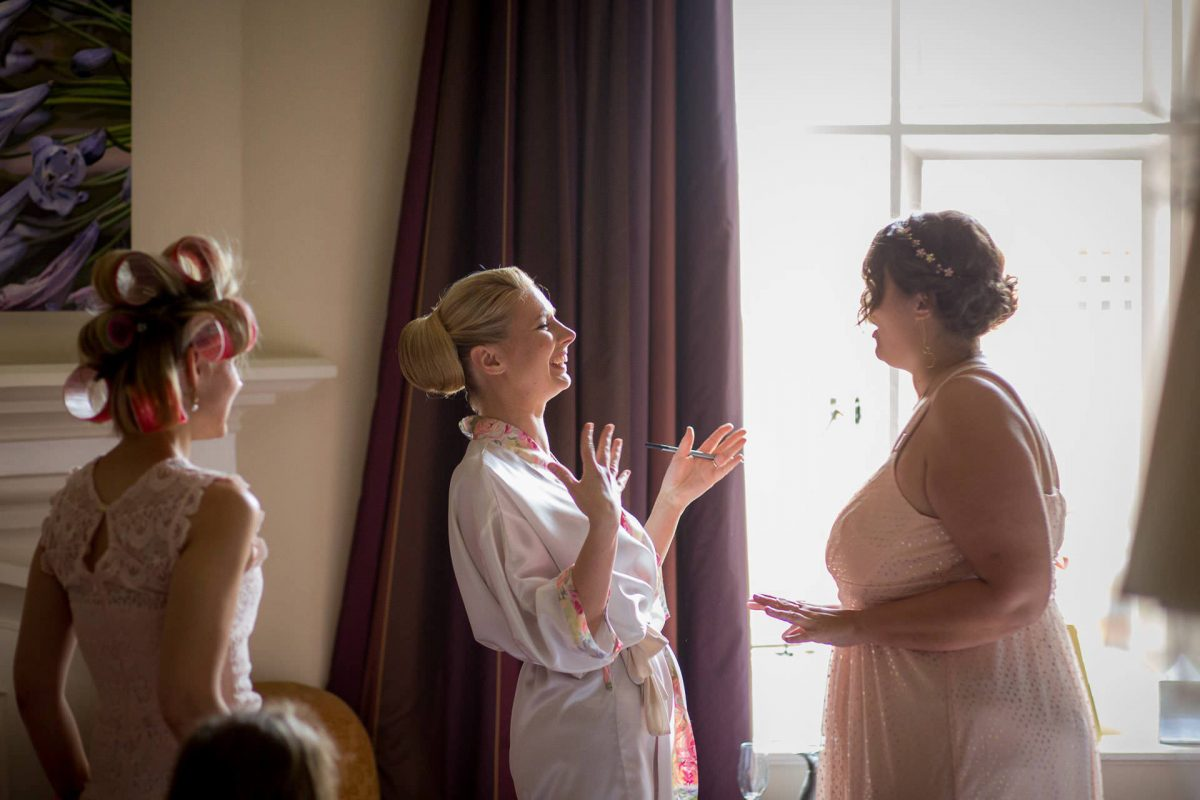 Wotton House wedding bride happy talking to her friend