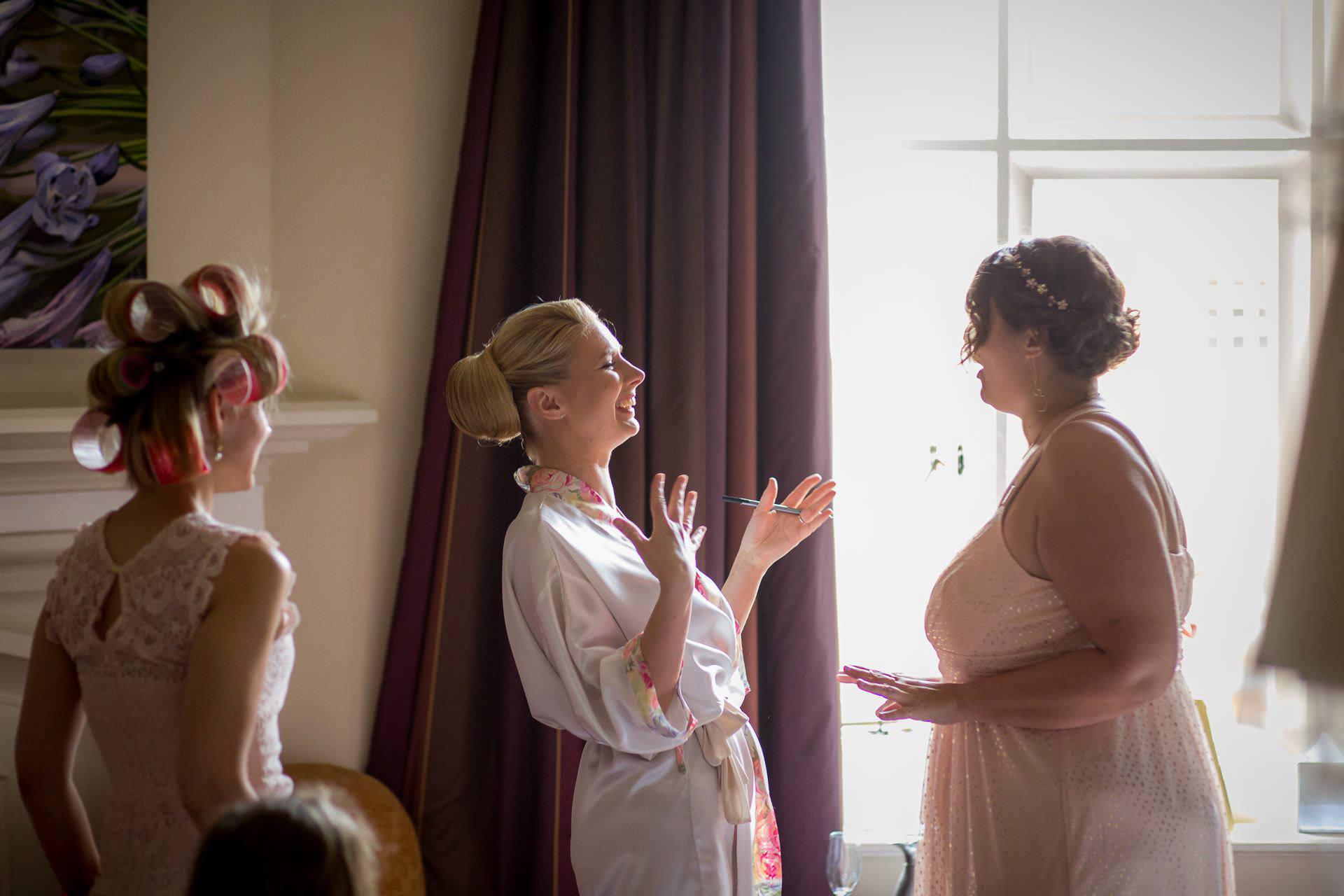 Wotton House wedding bride happy talking to her friend