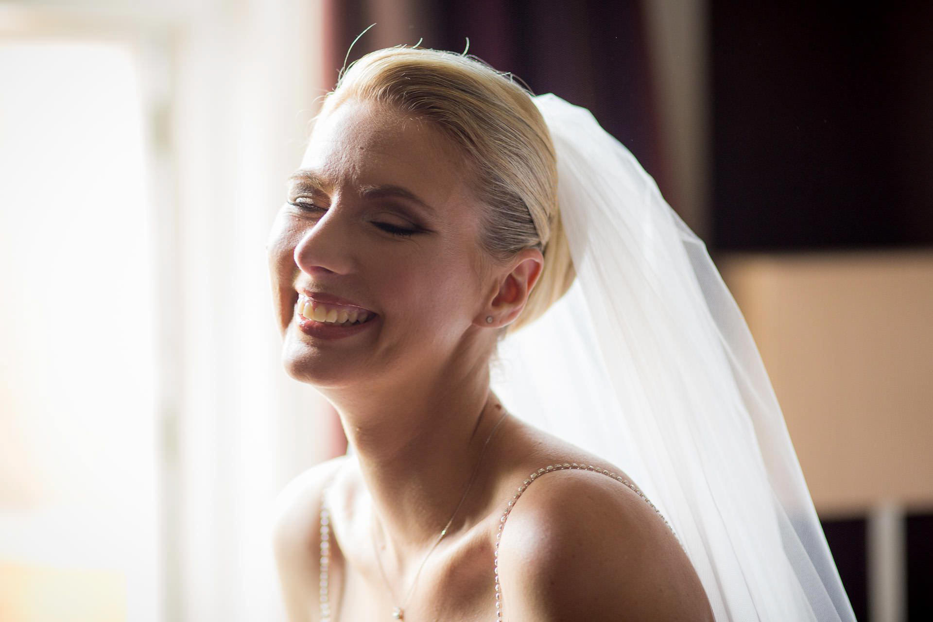 Wotton House wedding bride laughing
