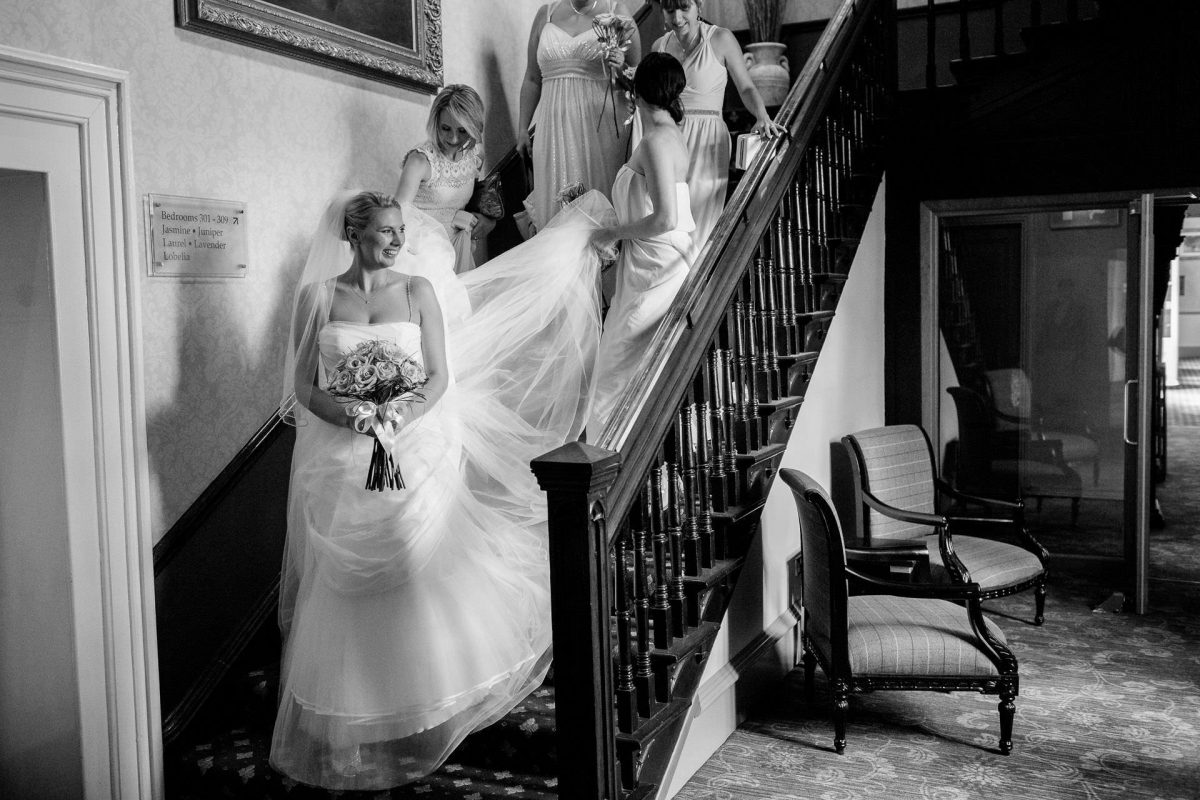Wotton House wedding bride walking down the stairs