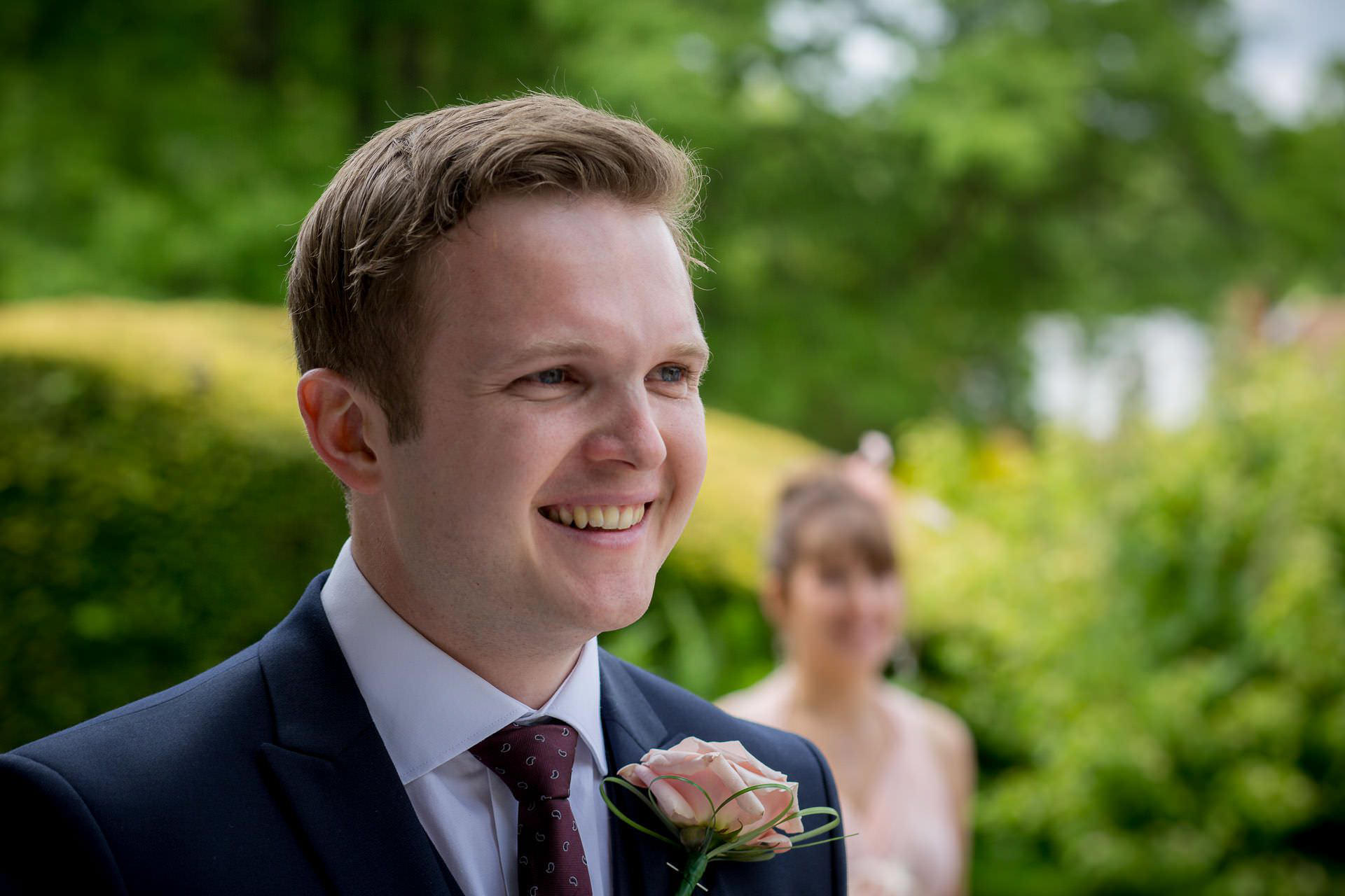 Wotton House wedding groom looking the the bride
