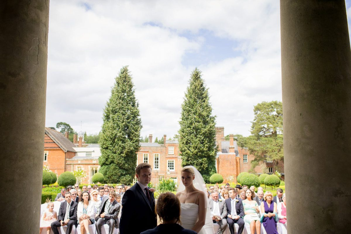 Wotton House wedding bride and groom in front of their guests