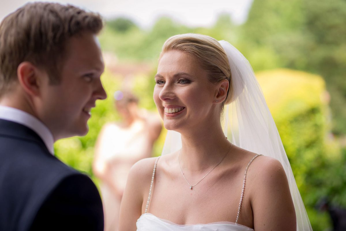 Wotton House wedding bride smiles to the groom