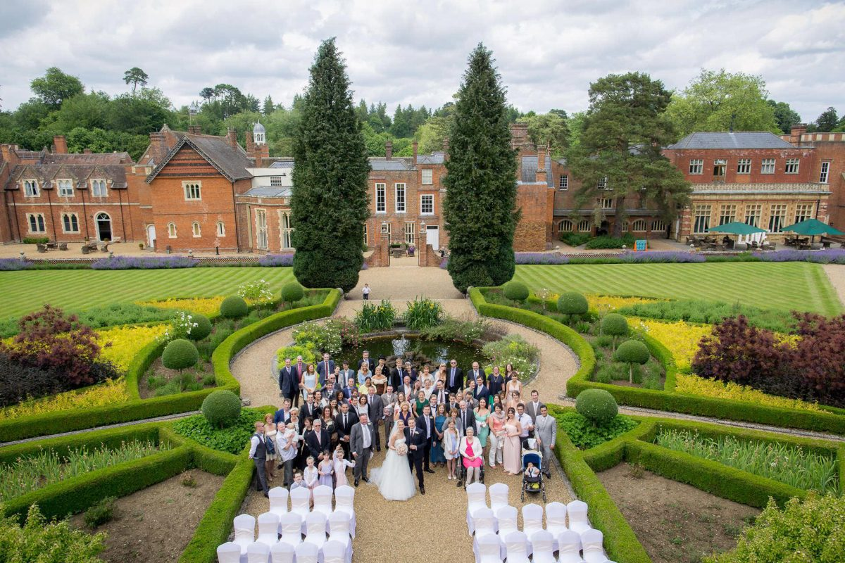 Wotton House wedding group photo with the view of the venue