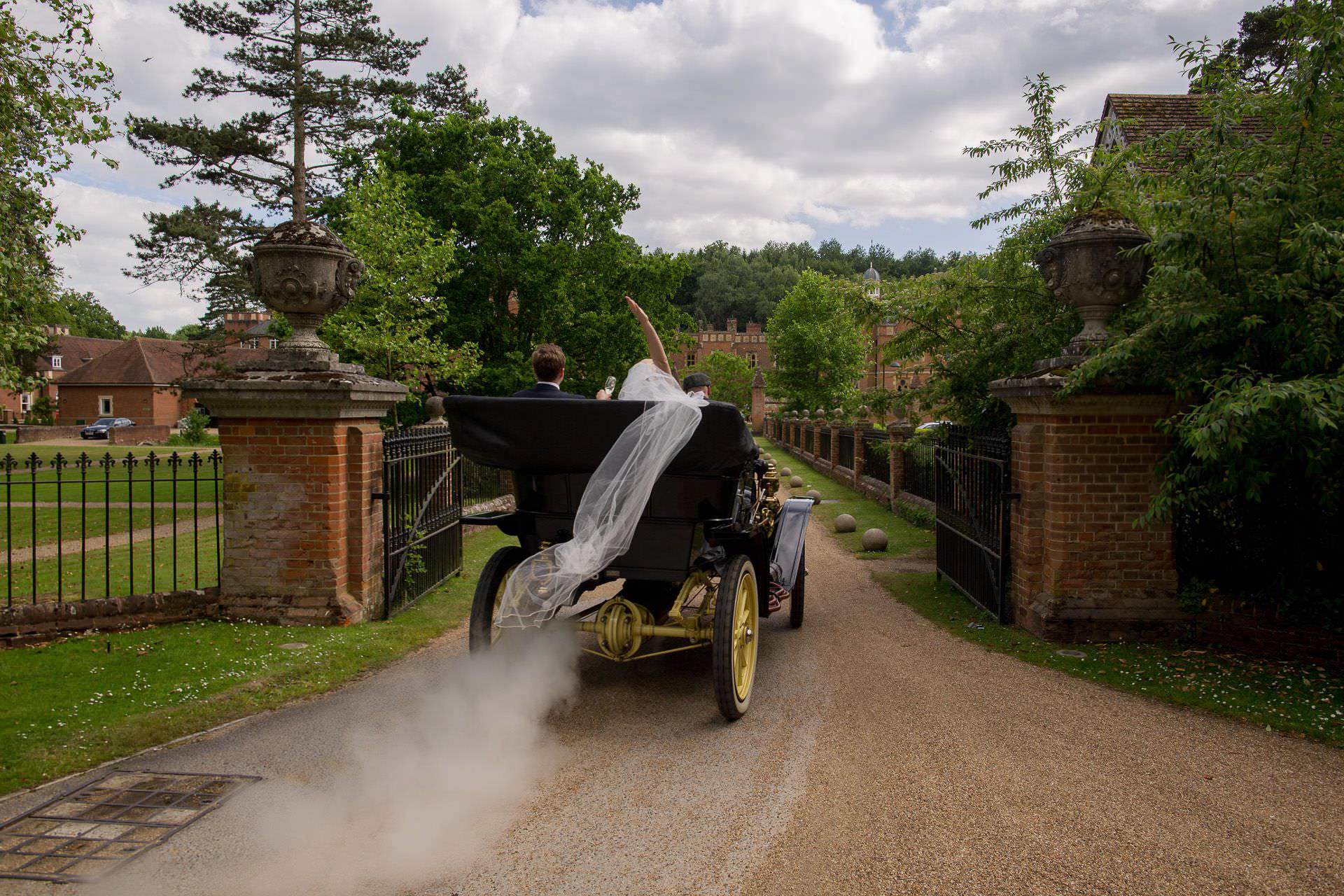 Wotton House wedding married couple enter the venue in the steam car