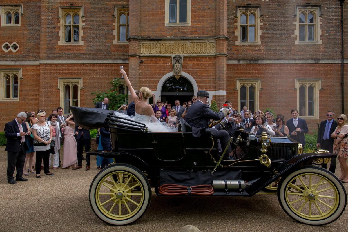 Wotton House wedding couple greeted by the guests