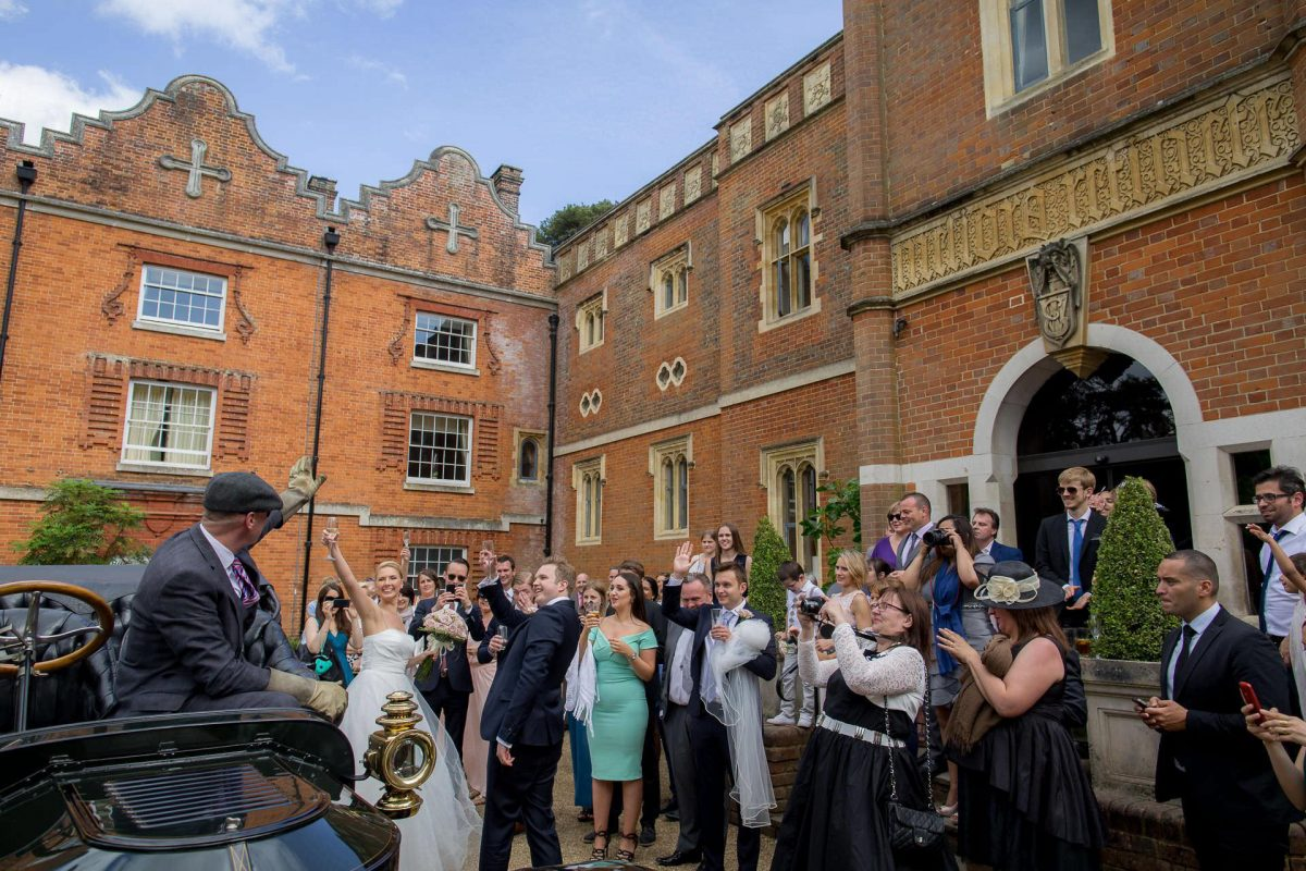 Wotton House wedding guests greet the couple