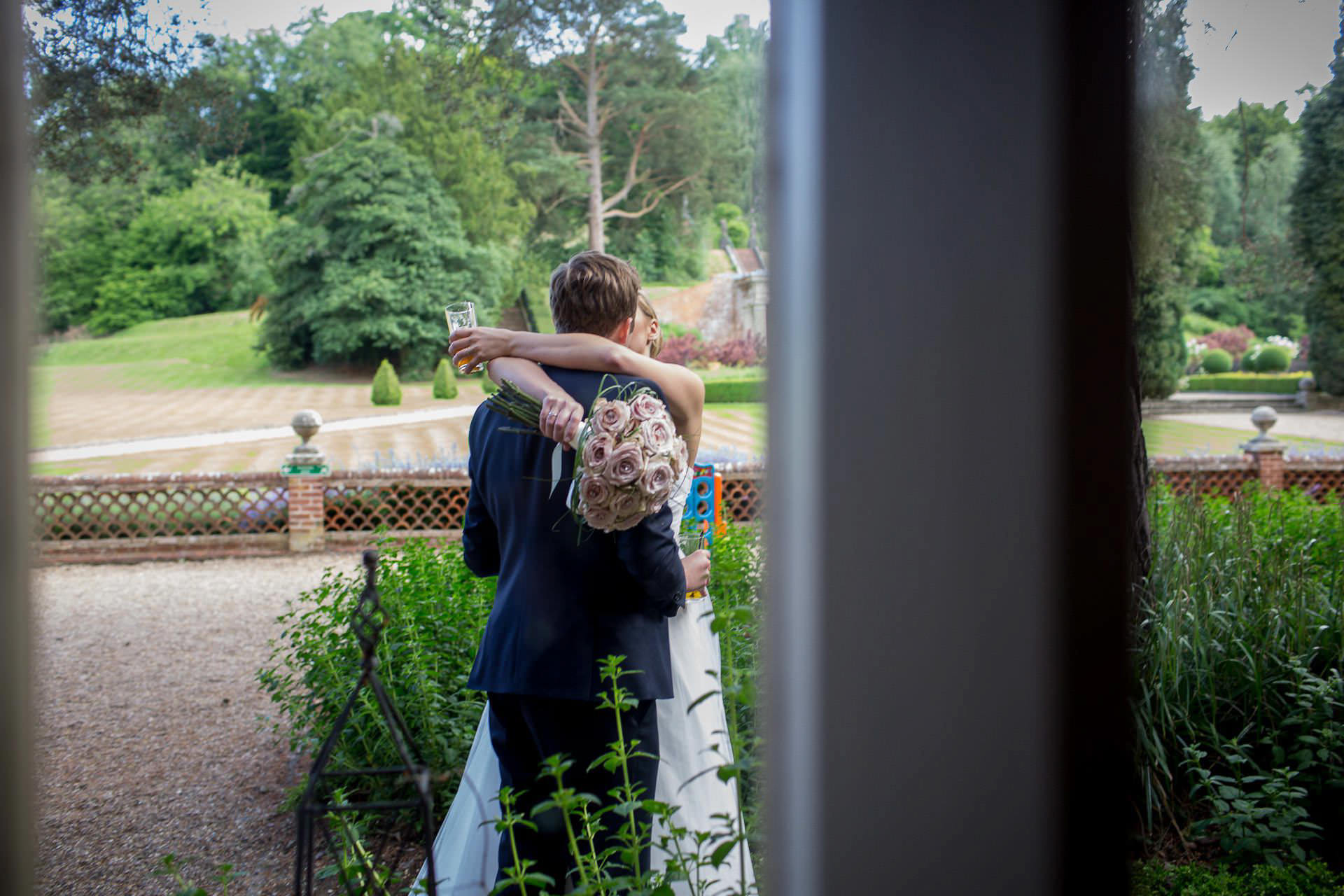Wotton House wedding bride and groom cuddling each other