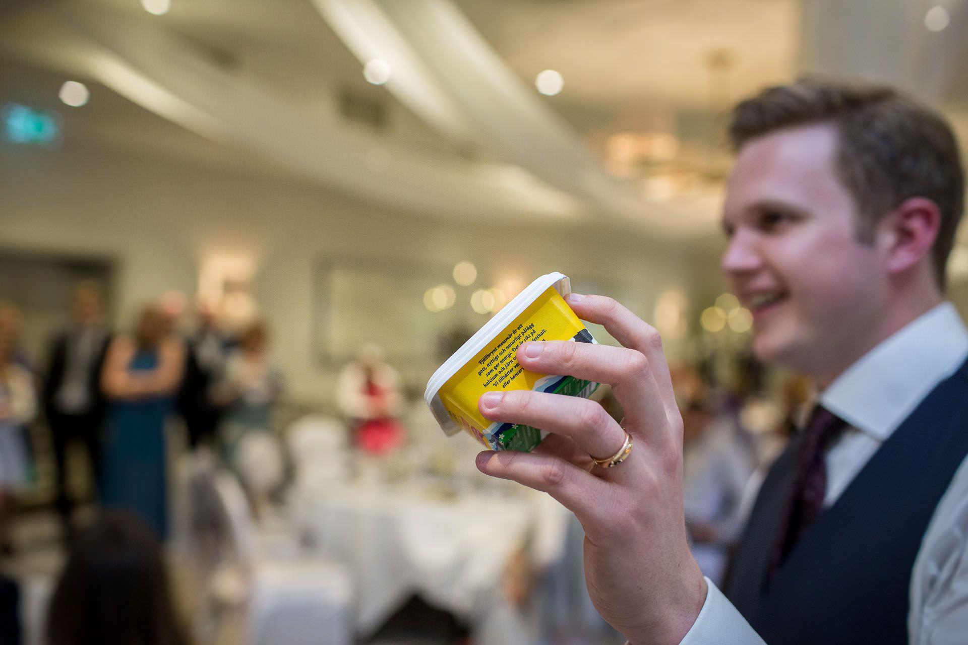 Wotton House wedding groom holds butter