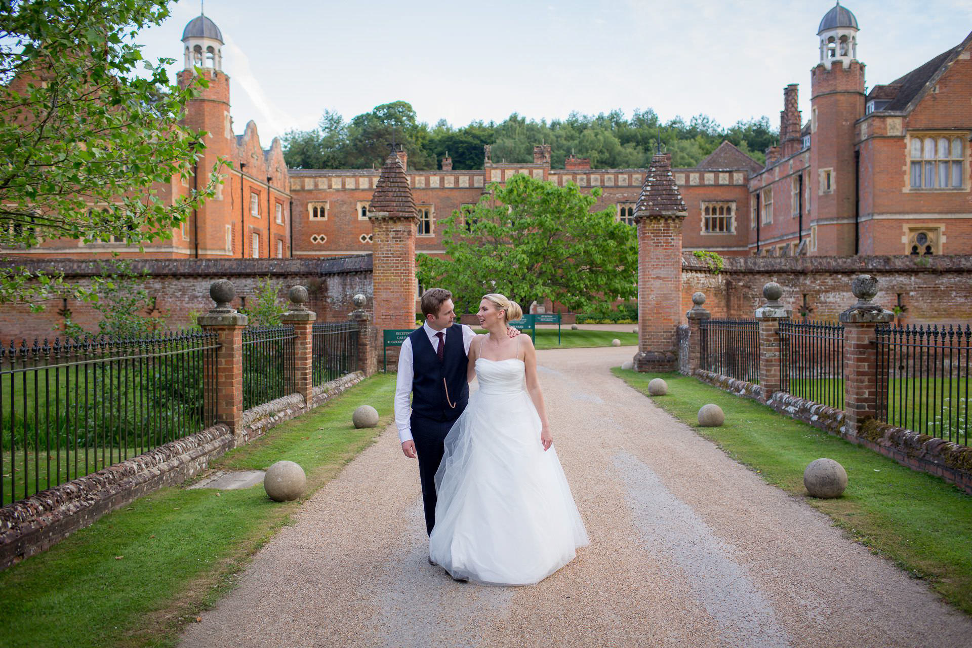 Wotton House wedding couple walking in front of the hotel