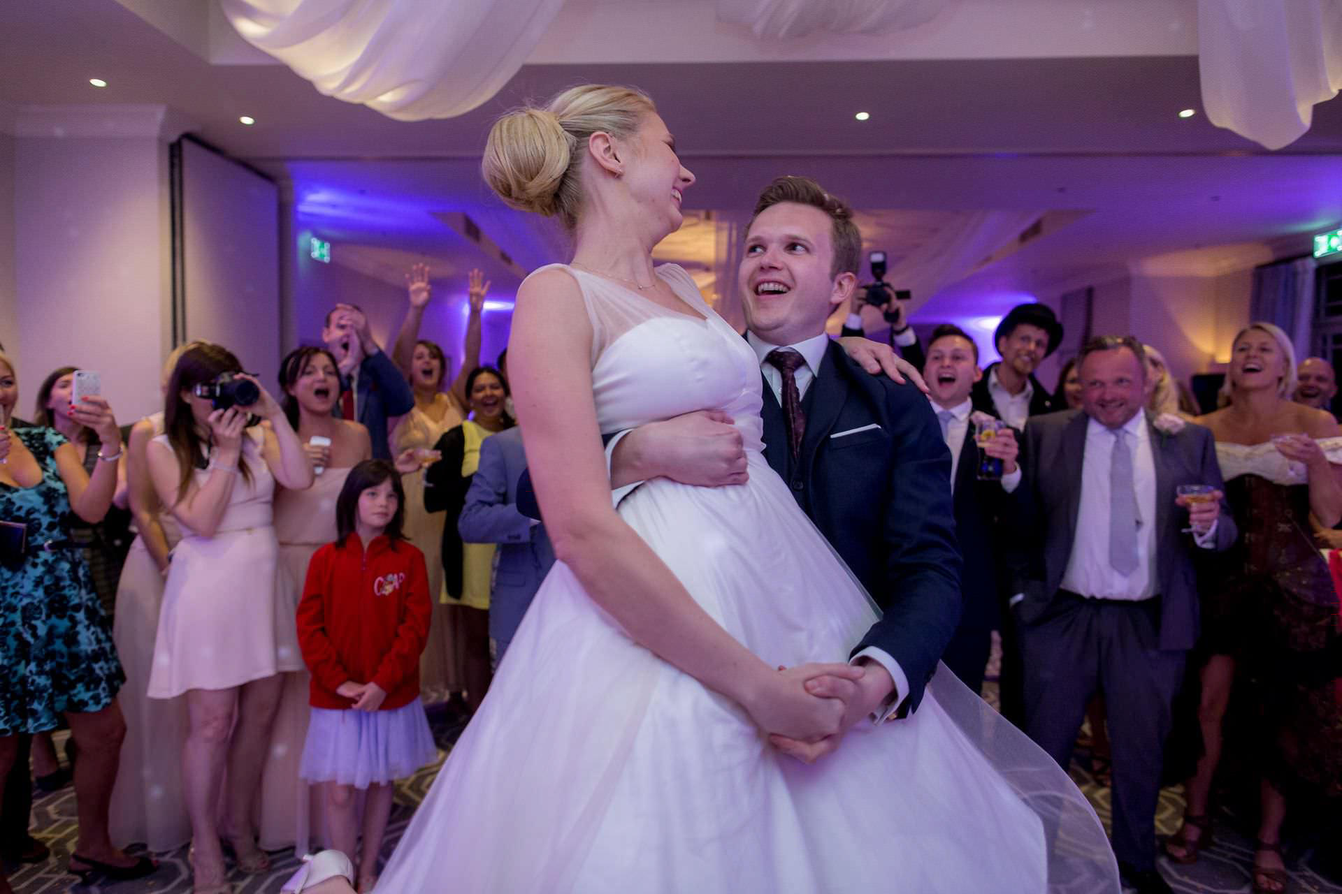 Wotton House wedding groom holds the bride during the first dance