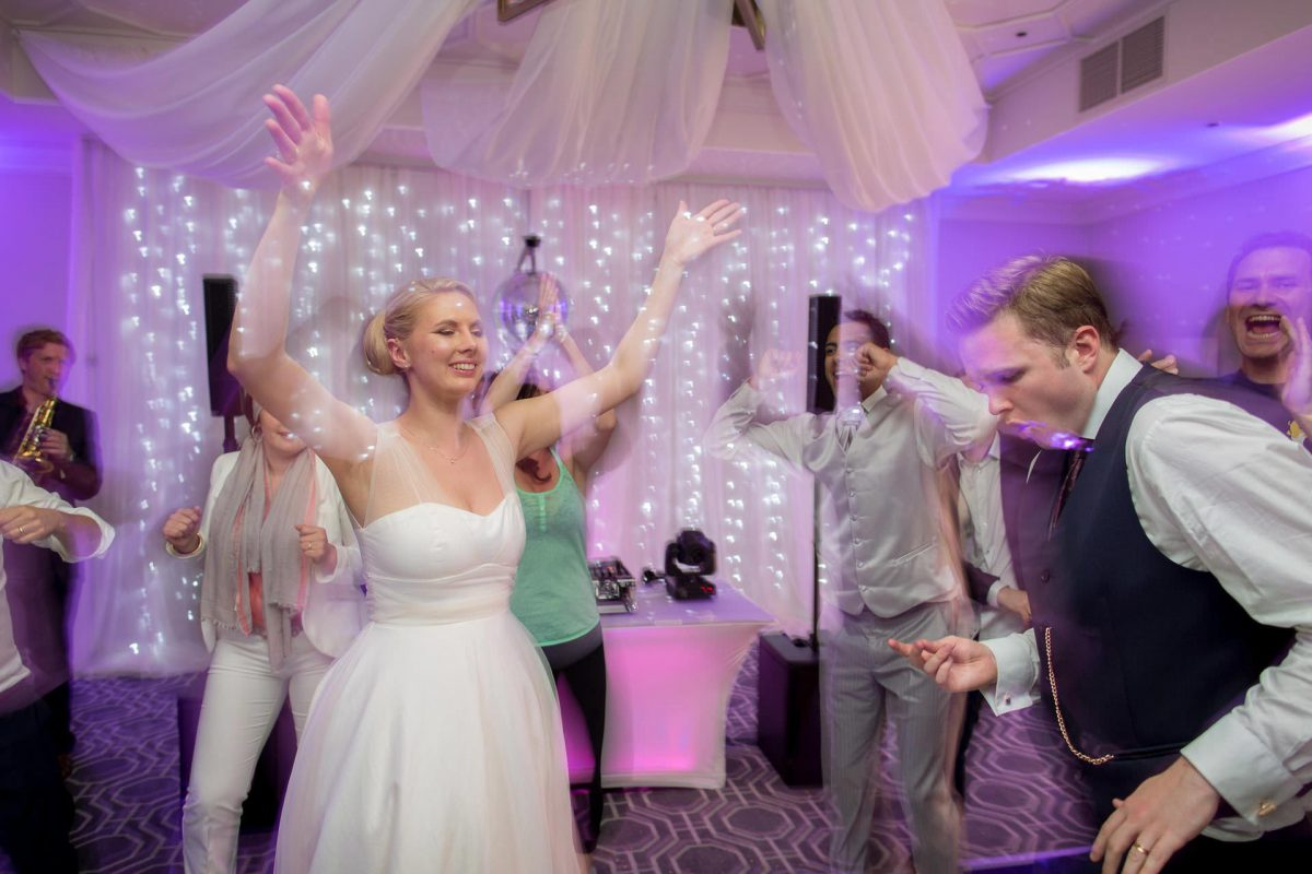 Wotton House wedding bride holds hands in the air